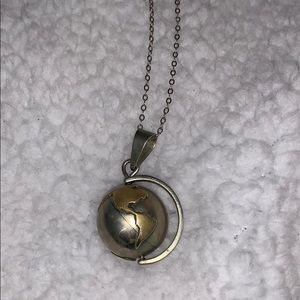 Jewelry - Earth Bell Pendant Spins w/Silver Chain